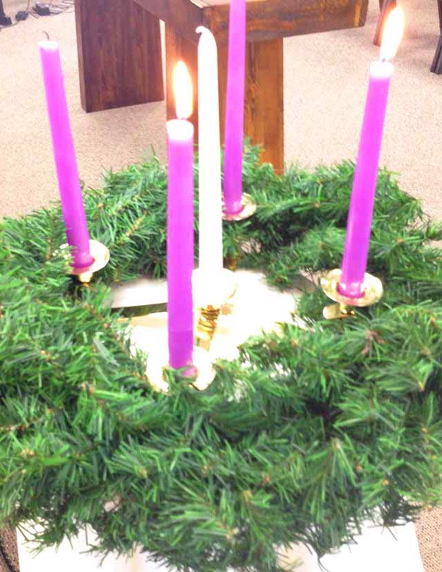 Advent wreaths and little pyromaniacs just don't mix. Most little boys are preoccupied with fire. This one is no exception.
