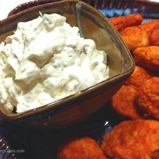 Blue Cheese Dip is a great accompaniment to buffalo wings. The creamy dip cools the spiciness of the wings.
