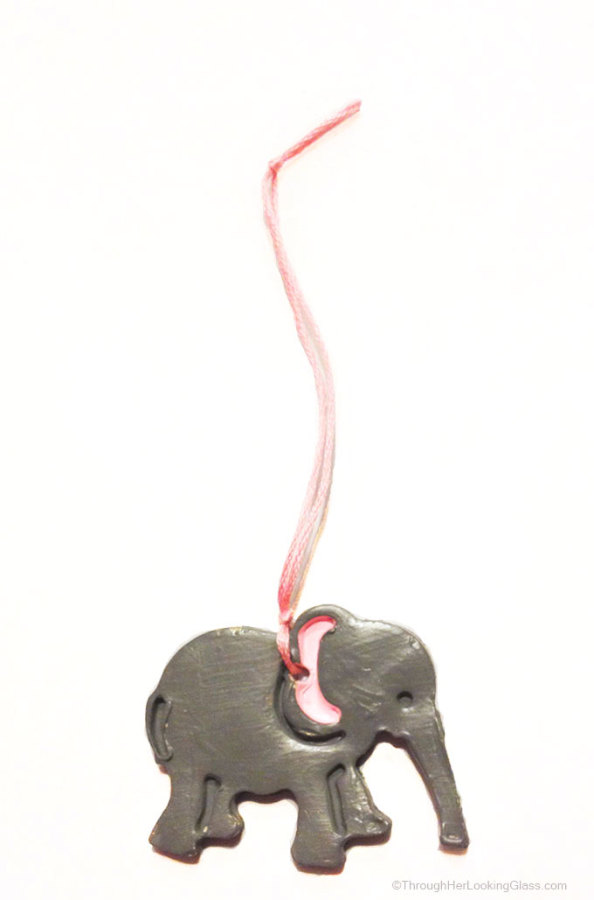 DIY Clay Elephant Christmas Ornaments. Quick to make, fun to gift. Animal Cracker cookie cutters make such cute little ornaments.