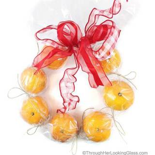 Festive, easy Christmas gift. This DIY Clementine Wreath will be a big hit this Christmas season.