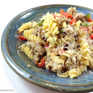 Sausage Pepper Pasta Toss. Easy and satisfying. Flavorful winter main dish with just five ingredients. Parmesan and cream combine to make cheese sauce. Yum!