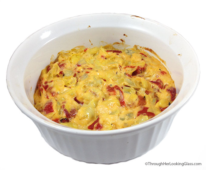 Baked Cheesy Artichoke Dip. Mmmmm. Creamy, melty parmesan, garlic, artichokes and sweet roasted red peppers. Serve with veggies, pita chips, blue corn chips