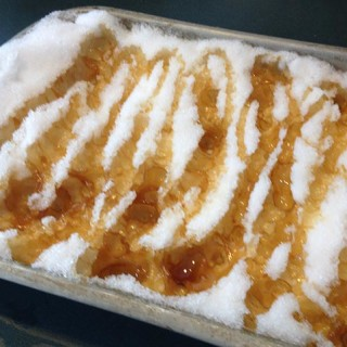 Delicious Maple Taffy on Snow. An old-fashioned French tradition. Boil the syrup, sugar, butter and vanilla. The taffy caramelizes and hardens on the snow.