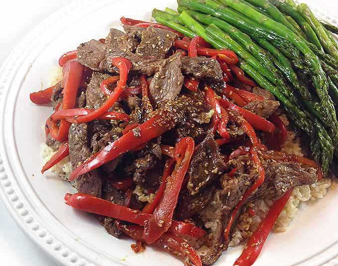 Sesame Beef & Red Peppers w/Roasted Asparagus. Try a relaxed night in, great food and great company. Sesame Beef, Roasted Asparagus and stunning Chocolate Raspberry Tart.