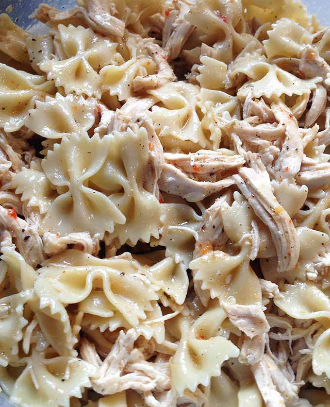 Chicken Artichoke Pasta Salad with Sun Dried Tomatoes: a bold tasting main dish pasta salad. Perfect for spring and summer, picnics and outdoor concerts.