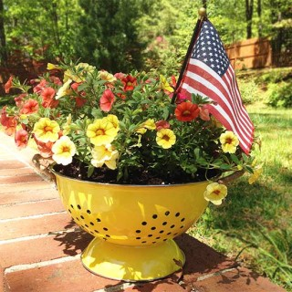 This DIY Colander Planter is so easy to make & adds a touch of whimsy to your porch or patio. This pretty planter is like a breath of fresh air.