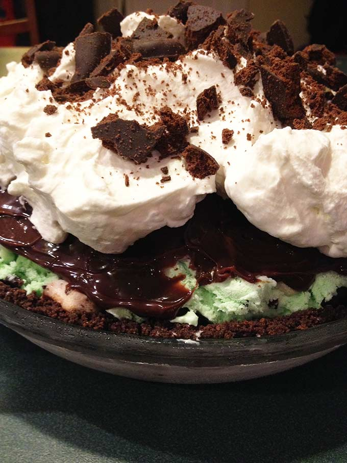 Fudgy Grasshopper Ice Cream Pie: a refreshing summertime treat. If you're into ice-cream pies with ice cream, fudge & cookie layers, this is perfect!