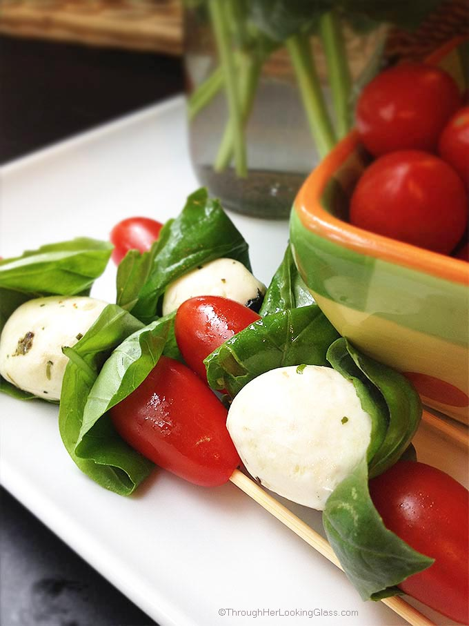 Caprese Mini Kabobs: a quick healthy treat. The easiest most colorful garden fresh appetizer you'll ever make. The perfect accompaniment to grilled burgers.