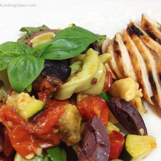 Roasted Veggie Mediterranean Tortellini. Fresh pasta salad. Eggplant, red pepper, tortellini, kalamata olives, cherry tomatoes, basil, zucchini.