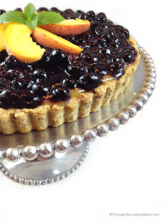 Blueberry Peach Tart. Buttery pecan tart crust with luscious layers of peaches and blueberries. Garnish with fresh peaches and whipped cream.