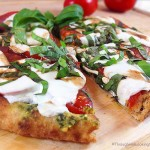 Caprese Pesto Flatbread. Fresh basil pesto, tomatoes, fresh mozzarella and drizzle of balsamic vinegar combine for a fresh & delicious flatbread pizza.