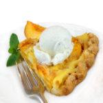 Peach custard pie with vanilla ice cream on top