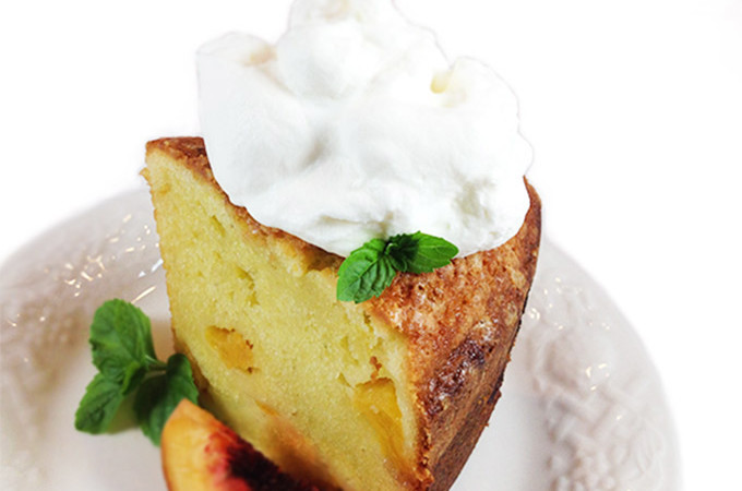 Fresh Peach Pound Cake. Ripe peaches, butter, sour cream, vanilla & almond extracts give exceptional flavor! Buttery southern peach pound cake to die for.