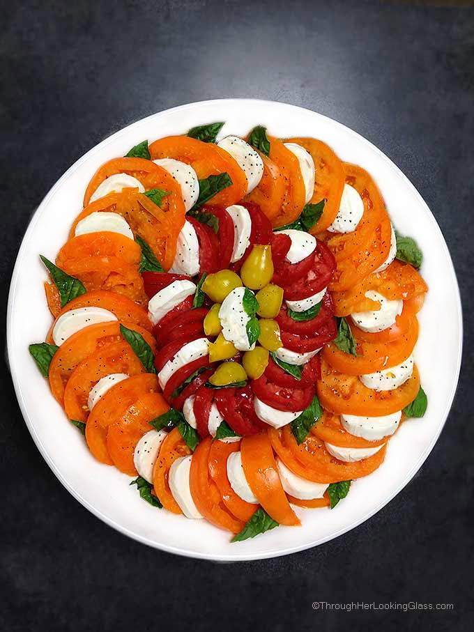 Caprese Salad Tomatoes: spectacular & easy to make. This platter features Orange Wellington, Opalka, and Yellow Pear tomatoes. Sweet and delicious.
