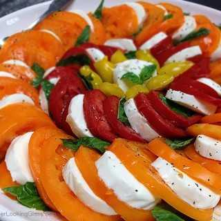 Caprese Salad Garden Tomatoes: spectacular & easy to make. This platter features Orange Wellington, Opalka, and Yellow Pear tomatoes. Sweet and delicious.