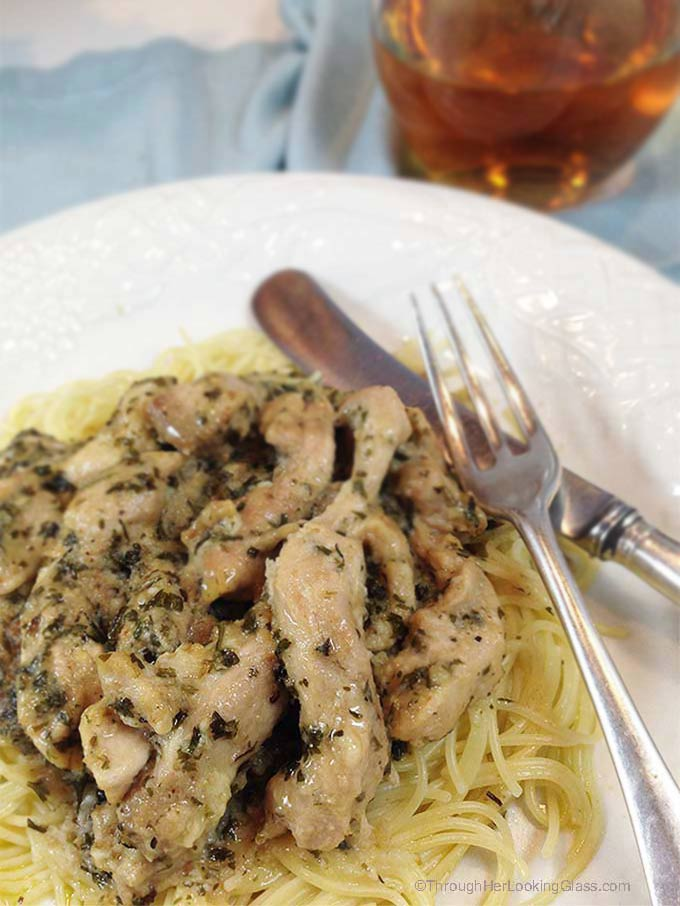 Chicken Scampi: easy, company-worthy dinner for any night of the week. Garlic, olive oil and herbs smother boneless chicken for a delicious, flavorful meal!