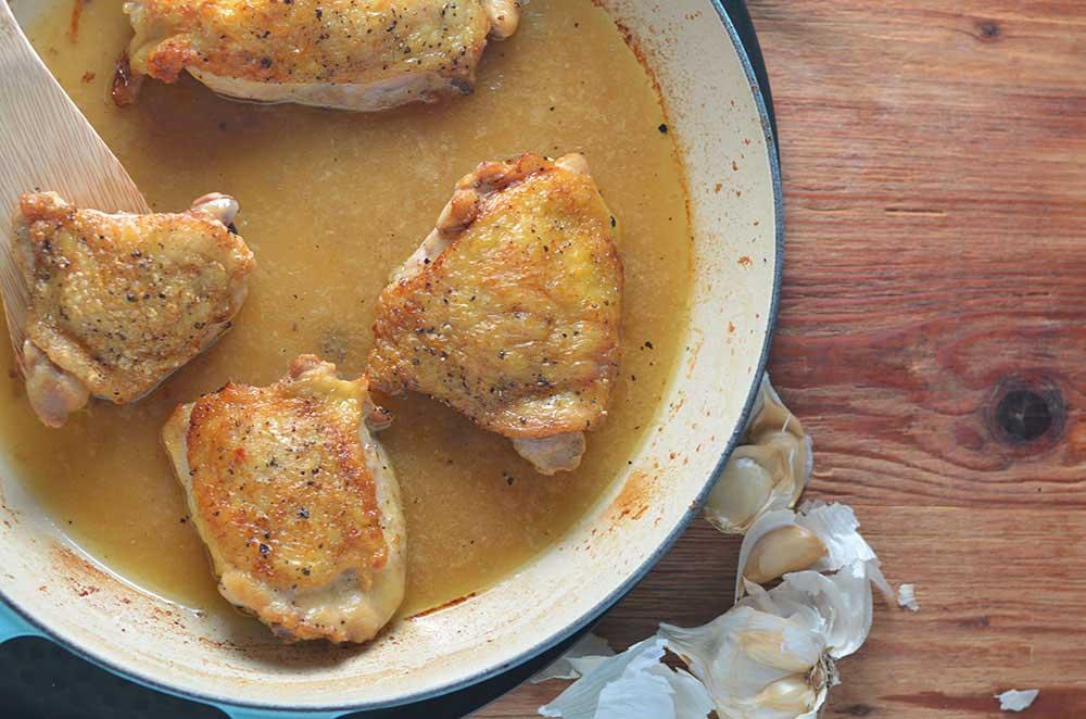 Garlic Chicken Thighs: tender chicken thighs in garlic sauce w/crispy, delicious skin. Easy. Chicken stock & garlic bring extra flavor to the table.