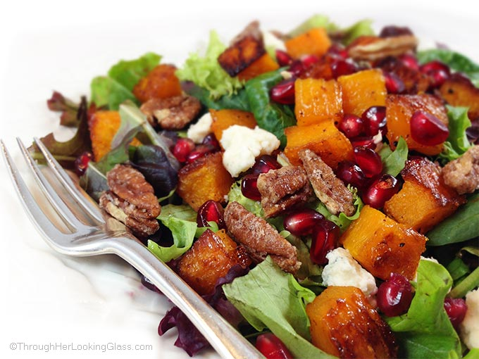 Maple Roasted Butternut Squash & Pomegranate Harvest Salad. The butternut squash is golden and caramelized. Zippy homemade pomegranate blender dressing.