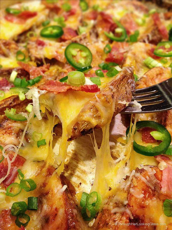 Cheesy Jalapeno Bacon Steak Fries: scrumptious appetizer or main dish. Crispy cheese smothered steak fries w/ bacon crumbles, green onions & jalapenos.