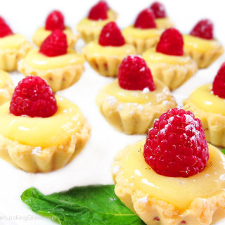 Irresistible Raspberry Lemon Tartlets. Crunchy, light tart shells layered with seedless raspberry jam, lemon curd and fresh raspberries. Need I say more?