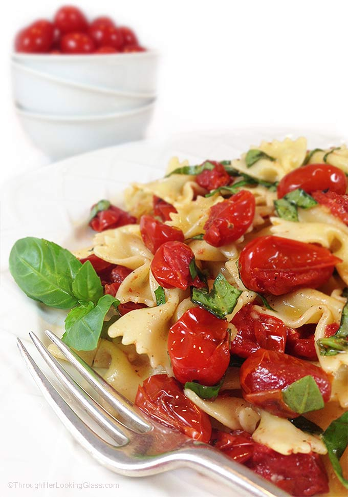 Blistered Tomato Basil Pasta Salad w/Truffle Oil. Ideal summer side dish. Garlic mingles w/basil, blistered tomatoes & farfalle pasta. Irresistible!