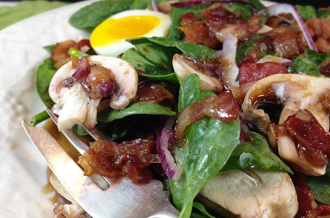 Maple Warm Bacon Dressing Spinach Salad: sweet maple syrup combines with warm bacon dressing atop spinach greens. Eating your greens never tasted so good!