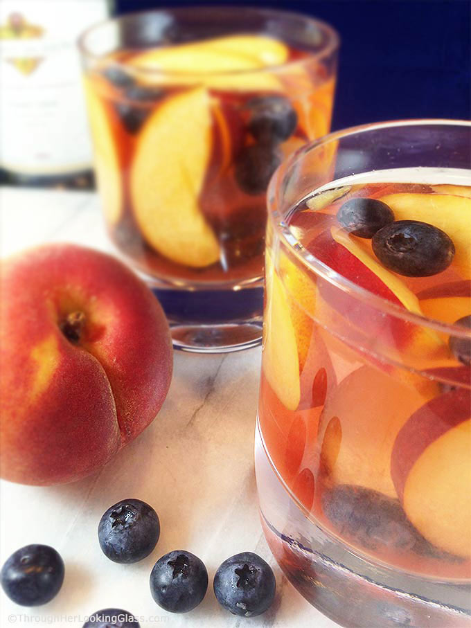 Fruity White Wine Peach Sangria - Through Her Looking Glass