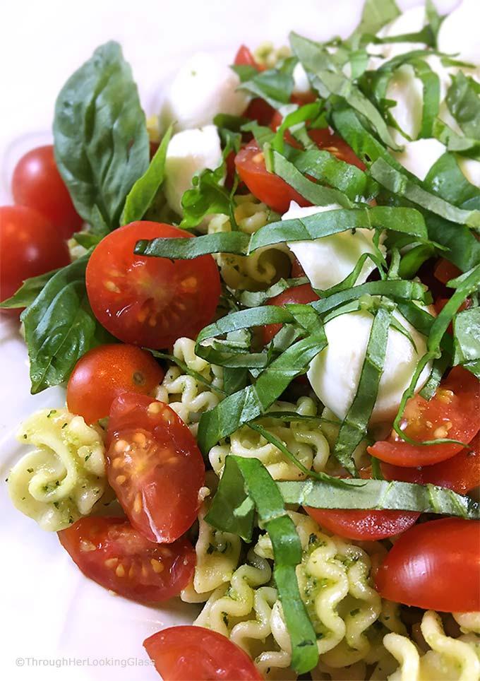 This Caprese Pasta Salad Recipe: perfect side incorporating your garden basil! Fresh basil pesto, pasta, sun-ripened tomatoes and fresh mozzarella. Delish!