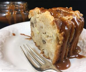 A piece of apple cake with salted caramel on top
