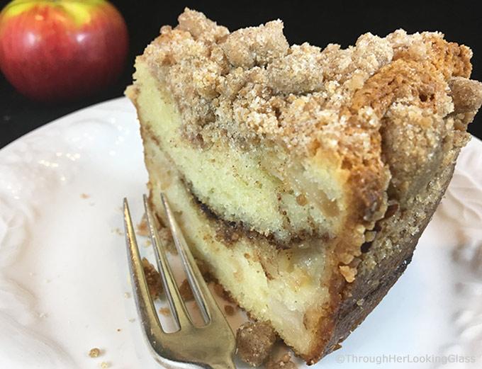 Tender Cinnamon Streusel Apple Coffee Cake: your new favorite sour cream coffee cake. Packed with apples, cinnamon filling & a crumbly cinnamon streusel.