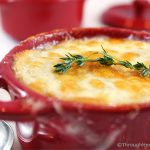 Apple Cider Caramelized Onion Soup is a sweet and flavorful version of your favorite French onion soup. Apple cider, chicken and beef broth simmer with sweet onions and thyme. Topped with a slice of French bread and bubbly sharp cheddar cheese, this is a delicious main dish or appetizer soup.