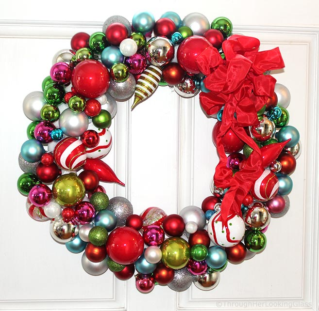 This Willy Wonka Christmas Ball Wreath is a fun and sparkly way to welcome in the Christmas holidays. Easy to make too. Just hot glue Christmas ornaments of various colors, shapes and sizes onto a styrofoam wreath form.