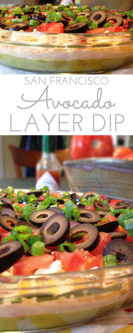 San Francisco Avocado Layer Dip: zippy guacamole dip with greek yogurt, taco seasoning, cheese, tomatoes, olives, green onions and hot pepper sauce.