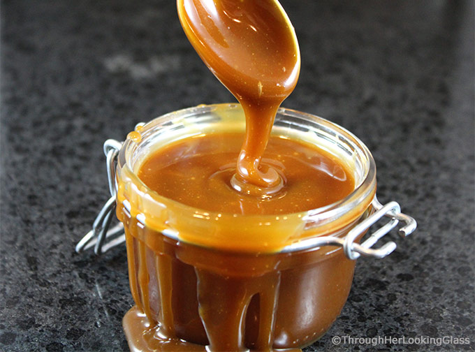 Homemade Salted Caramel Sauce: easy to make & just four ingredients. A drizzle of this velvety smooth salted caramel sauce elevates any dessert to stardom.