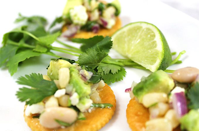 Easy Spring Appetizers w/Fresh Herbs! Herbs mingle w/veggies, cheese and fresh ingredients to create flavorful, scrumptious toppings for Ritz Crackers!