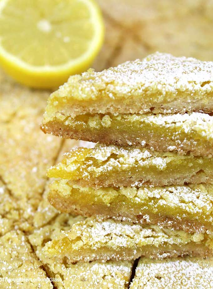 Lemon Slice Recipe: rich and lemony, these buttery Lemon Slices will take you back to the glass case at the old-fashioned bakery. Fresh lemon juice & zest!