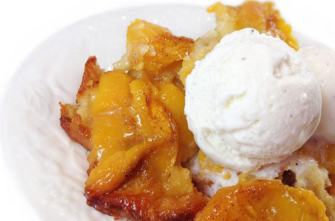 Roasted Peach Cobbler. The batter underneath cooks, bubbles up all around the peaches. Gets all crispy and yummy on the edges. Fabulous!!!