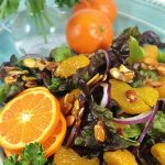 Mandarin Orange Salad: candied almonds combine w/sweet mandarins, red onion & a sweet spicy dressing for a delicious & colorful salad. This disappears fast!