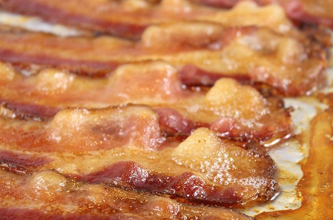 How to Bake Bacon in the Oven. Baking bacon is so much easier (and less messy) than frying it on the stovetop or cooking it in the microwave. Learn all the best tips to bake bacon in the oven today!