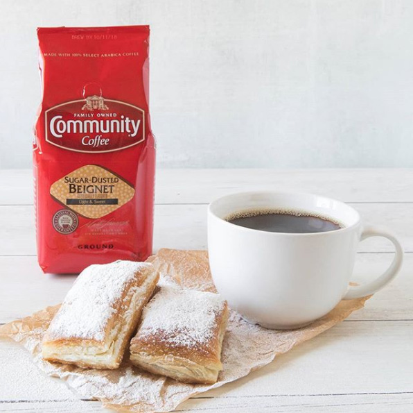 A mug of Sugar Dusted Beignet Coffee by Community Coffee