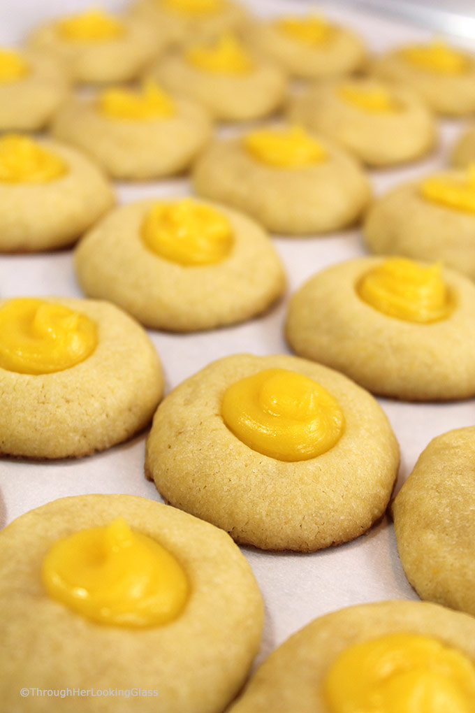 Here's a buttery shortbread Lemon Curd Easy Thumbprint Cookie Recipe for cheerful springtime baking! Buttery shortbread cookies nest dollops of yummy sweet & sour lemon curd. If you love lemon curd like I do, this is the easy cookie for you!