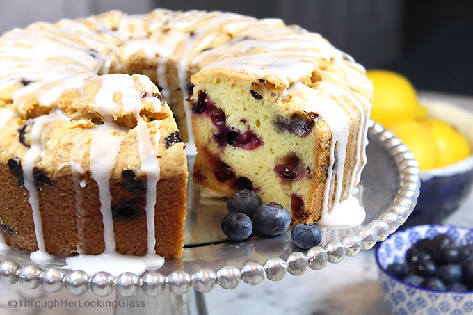 A generous slice of this Glazed Lemon Blueberry Pound Cake is especially scrumptious on the sun porch accompanied by a tall glass of fresh squeezed lemonade. And a sprig of mint. Tender, buttery lemon pound cake is studded with fresh, juicy blueberries for the perfect summer combo.