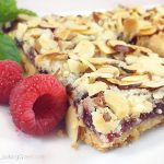 These old-fashionedPeach & Raspberry Shortbread Squares(w/Almonds)are perfect for picnics and lunch boxes this summer. Crunchy and sweet, buttery and packed with peach, almond & raspberry flavor.