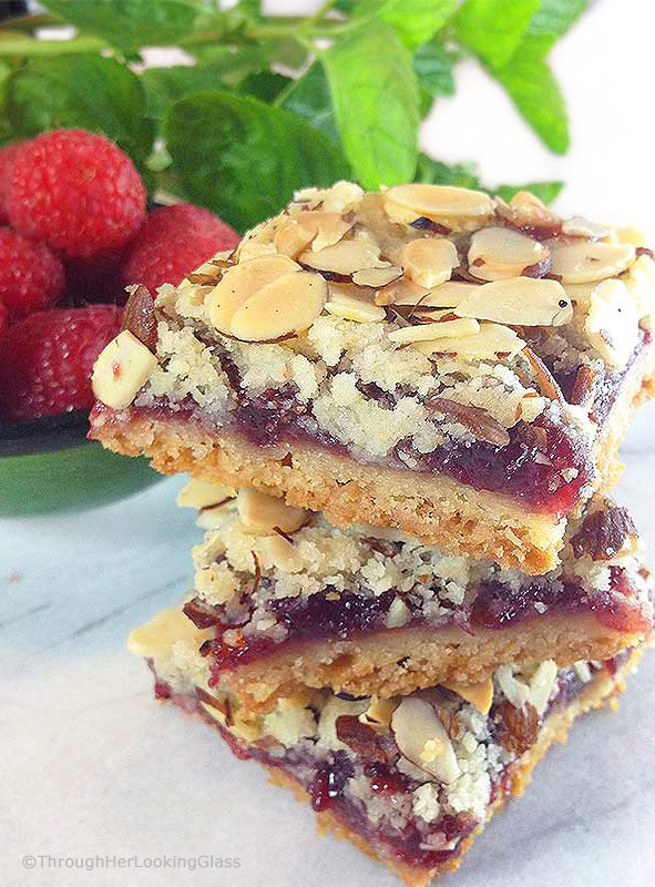 These old-fashioned Peach & Raspberry Shortbread Squares (w/Almonds) are perfect for picnics and lunch boxes this summer. Crunchy and sweet, buttery and packed with peach, almond & raspberry flavor.