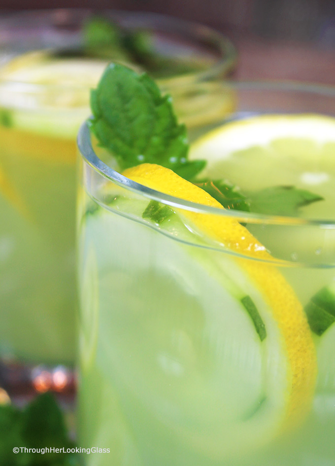 Mint Infused Cucumber Lemonade is a refreshing cold, all natural drink on a hot day. Sweet lemonade combines with fresh cucumber juice and muddled mint and is delicious iced! Refreshing cold sip for a hot summer's day.