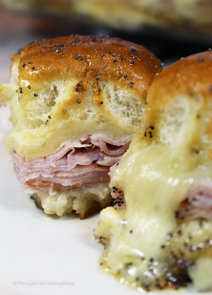 Brown Sugar Hawaiian Roll Ham Sliders w/VT Cheddar! Sweet King's Hawaiian rolls are layered with sliced ham and VT cheddar cheese. Then brushed with a sweet and spicy brown sugar glaze and baked.