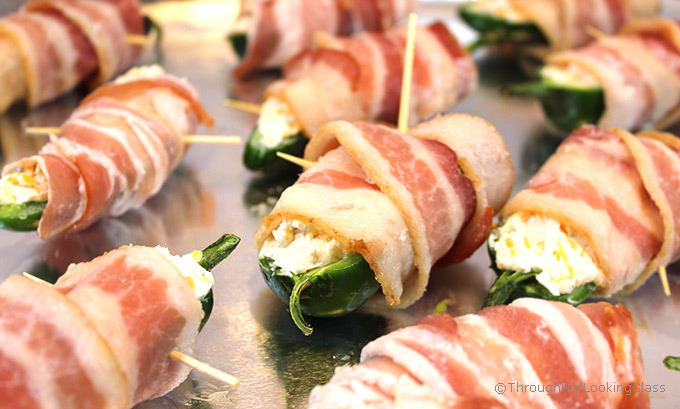 Crispy, cheesy and oh so addictive! Bacon Wrapped Stuffed Jalapeños are the most coveted game day appetizer on the planet. Fresh jalapeños are stuffed with a cream cheese cheddar mixture, then wrapped with bacon.